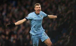 football-edin-dzeko-celebrates-after-scoring-the-third-goal-for-manchester-city